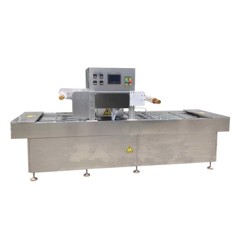 inline continuous vacuum skin packaging machine
